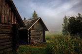 Russian bath in morning mist — Stock Photo