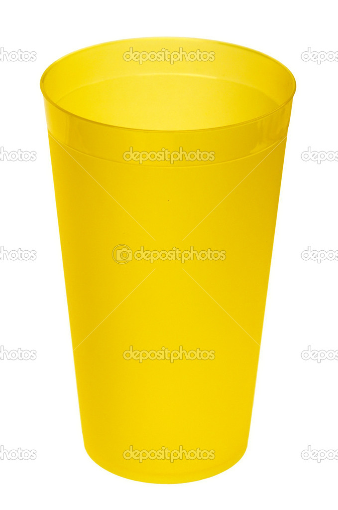 Yellow plastic glass for juice, isolated on white background. — Stock Photo #10107294