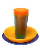 Multicolored plasticplates,cups, isolatedon white backgrou — Stock Photo