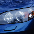 Automobile headlamp of a modern car. — Stock Photo