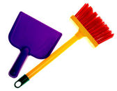 Toy plastic dustpan and broom isolated on a white background. — Stock Photo
