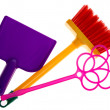 Toy plastic dustpan, carpet beater and broom isolated on a white — Stock Photo