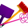 Toy plastic dustpan, carpet beater and broom isolated on a white - Stock Photo