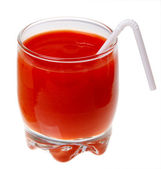 A glass of tomato juice and a straw isolated on a white backgrou — Stock Photo