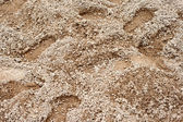 Footprints in the sand. Can be used as a background. — Stock Photo