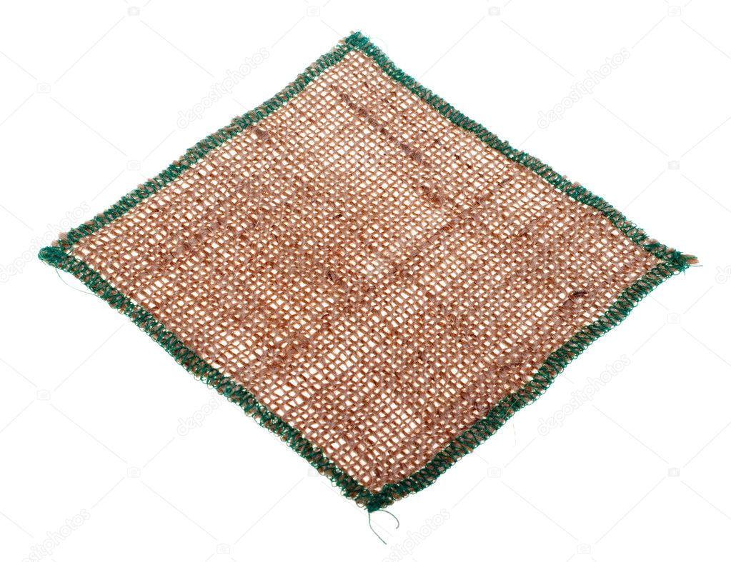 Tablecloth from burlap, isolated on a white background. — Stock Photo #9269711