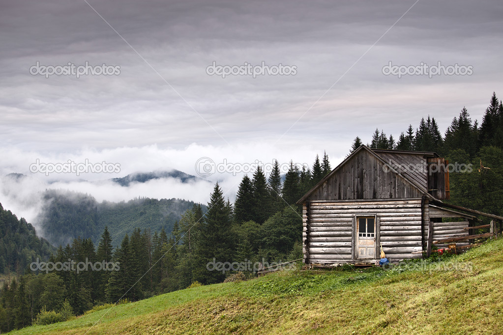 Abandoned wooden house at mountain hill — Stock Photo #9163103