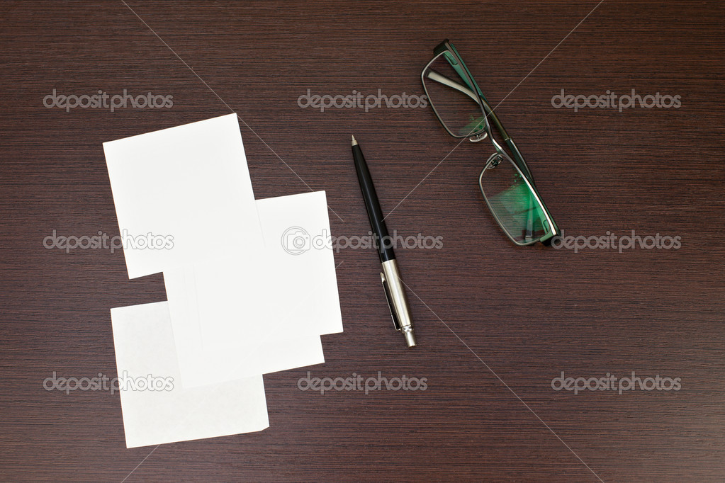 Paper note with pen and glasses on wooden background  Stock Photo #9164428
