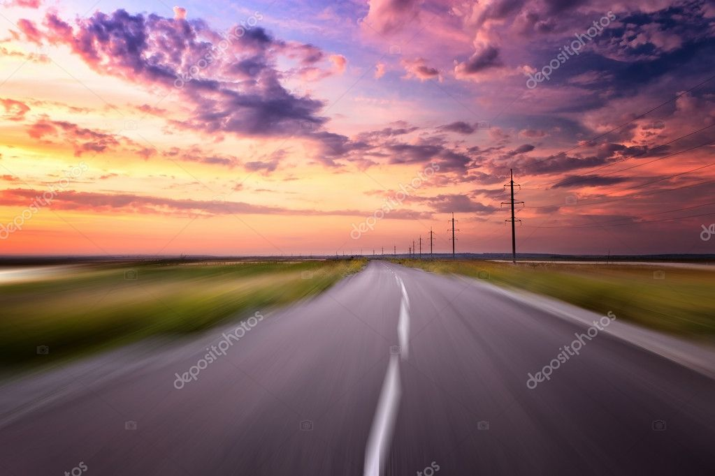 Moving at country road at sunset — Stock Photo #9178821