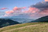 Mountain valley at cloudy sunset — Stock Photo
