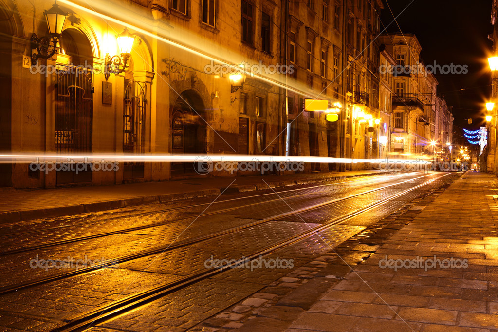 Traffic in old european city at night — Stock Photo #9186596