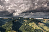 Mountain valley with dark rain clouds — Stock Photo