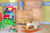Cozy baby room with toys — Stock Photo