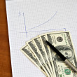 Pen and notepad with money — Stock Photo