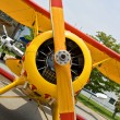 Propeller and engine of vintage airplane - Stock Photo