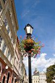 Flower arrangement on street lamp — Stock Photo
