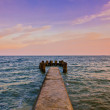 Sunset over calm sea waters — Stock Photo