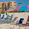 Shore with beach umbrella and chairs — Stock Photo