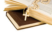Holy bible opened with a cross on it — Stock Photo