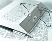 Close up of books, pen and glasses — Stock Photo