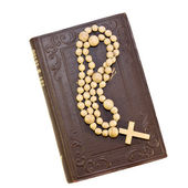 Rosary over an old holy bible — Stock Photo