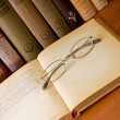 Old eyeglass on old book — Stock Photo #9296519