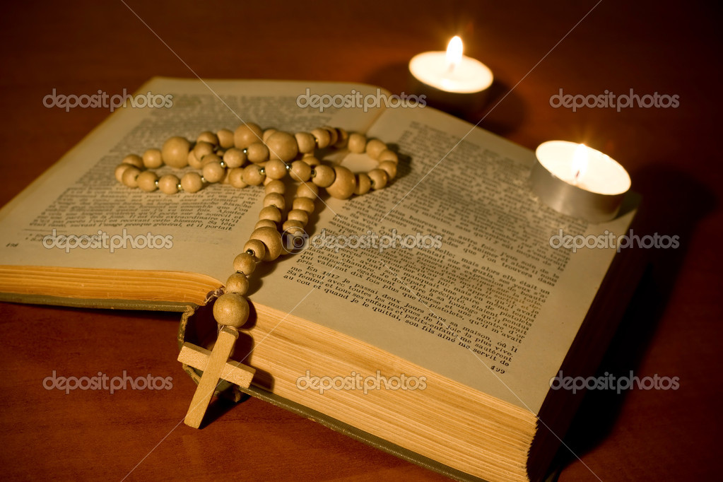 Cross over bible with candles  Stock Photo #9295629