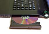 Laptop con un disco dvd — Foto Stock