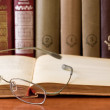 Stock Photo: Glasses with old hardcover books