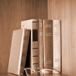 Stock Photo: Vintage photo of old books and glasses on shelf