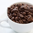 Coffee cup with coffee beans — Photo