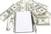 Pen, notepad and glasses on money background — Stok fotoğraf