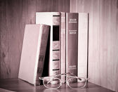 Retro books and glasses — Stock Photo