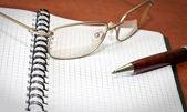 Glasses, notebook and pen — Stock Photo