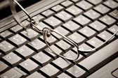 Glasses lying on the laptop — Stock Photo