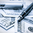 Pen and dollars — Stock Photo #9370173
