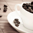 Old style photo of white cup of coffee — Stock Photo