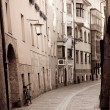 Retro style photo of typical european old town street — Stock Photo