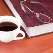 Cup of coffee with book and glasses - Stockfoto