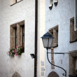 Street lamp on a wall - Stock Photo