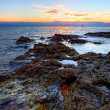 Sunset on the rocky coast of Black sea — Stock Photo