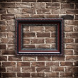 Picture frame on grunge brick wall — Stock Photo