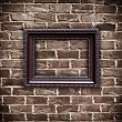 Picture frame on grunge brick wall — Foto de Stock