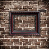 Rámeček obrázku na grunge cihlová zeď — Stock fotografie
