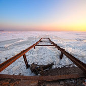 Frozen sea with broken pier — Stock Photo