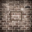 Empty frame on brick wall — Stock Photo