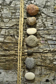Different types of stones on a hashed workbench, background — Stock Photo