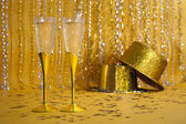 Two Gold Champagne Flutes with Sequined Party Hats — Stock Photo