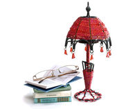 Lamp of beads and glasses on the books — Stock Photo