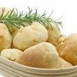 Olive bread rolls in a bread basket - Stock Photo